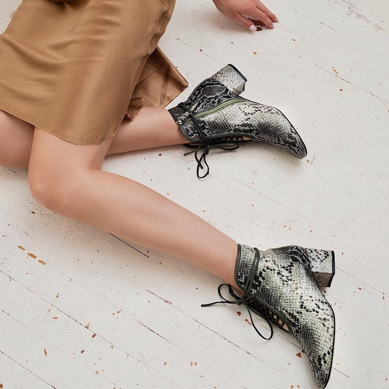 Daniella Shevel Cleo Green Printed Snake Leather Boot with low Heel on model with satin slip dress