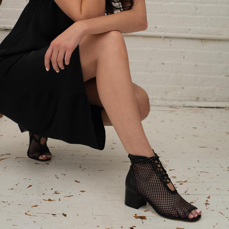 Daniella Shevel Nola Mesh Low heel Open Toe Bootie in Black on model with Black Dress