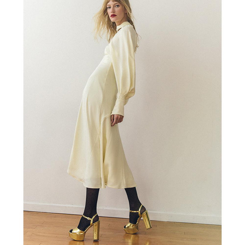 Daniella Shevel Vegan Gold Printed Crocodile Metallic Platform Heel Sandal On Model In A White Holiday Dress