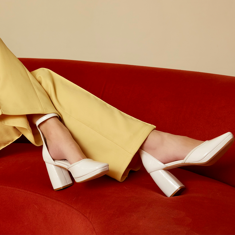 Daniella Shevel White Retro Lady Pumps with Yellow suit on retro sofa couch
