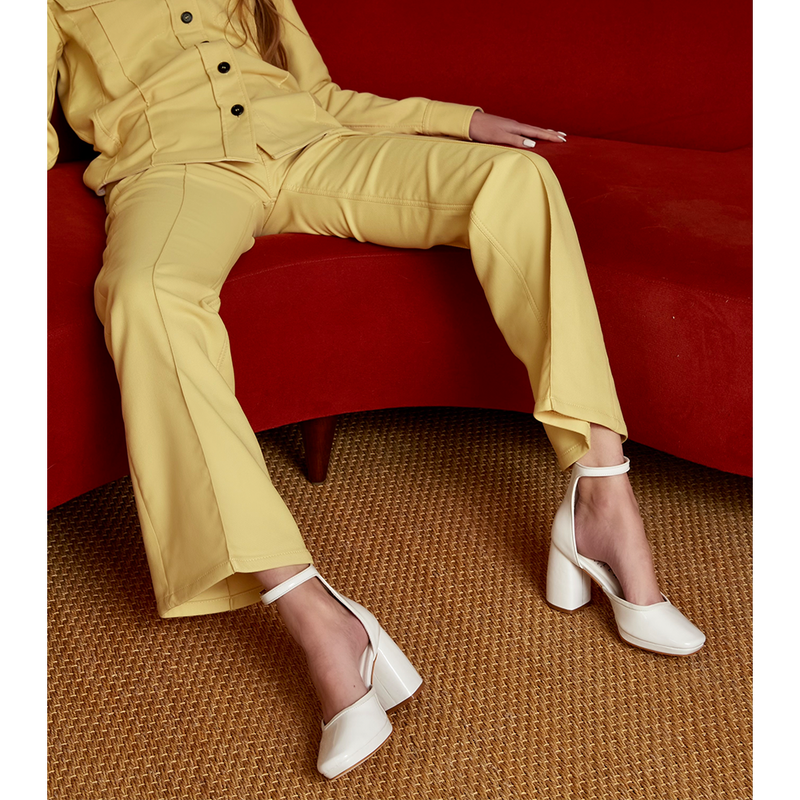 Daniella Shevel White Retro Lady Pumps with Yellow suit on retro sofa