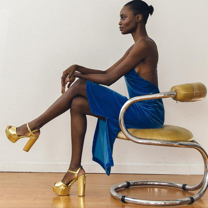 Daniella Shevel Vegan Gold Printed Crocodile Metallic Platform Heel Sandal On Model In a sexy velvet Holiday Dress