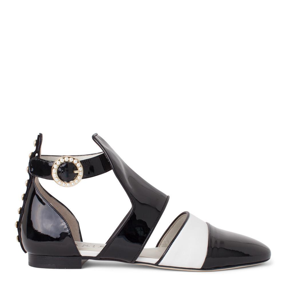 33b9321ce57 Daniella Shevel Women s Sandal in Black and White Patent Leather with Pearl  Accents Side View ...
