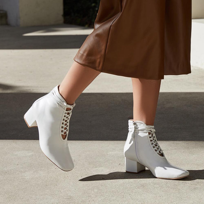Daniella Shevel Cleo White Nappa Leather Boot with low Heel on model with brown leather pants look
