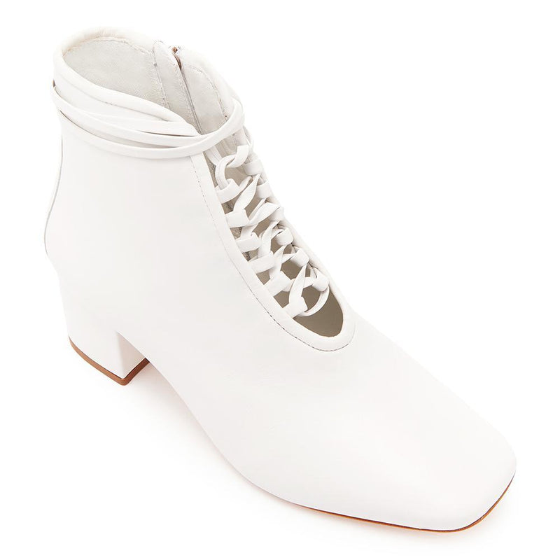 Daniella Shevel Cleo White Leather Bootie with Low Heel and White Laces Angle View