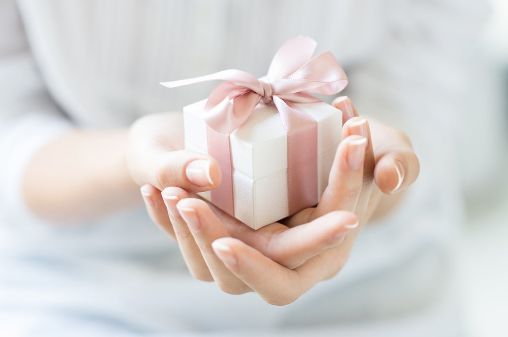 woman's hands giving gift