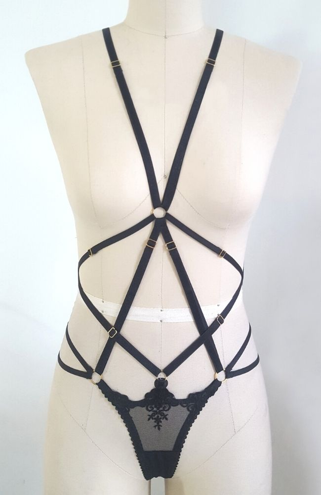 Black thong with a harness bodysuit attached