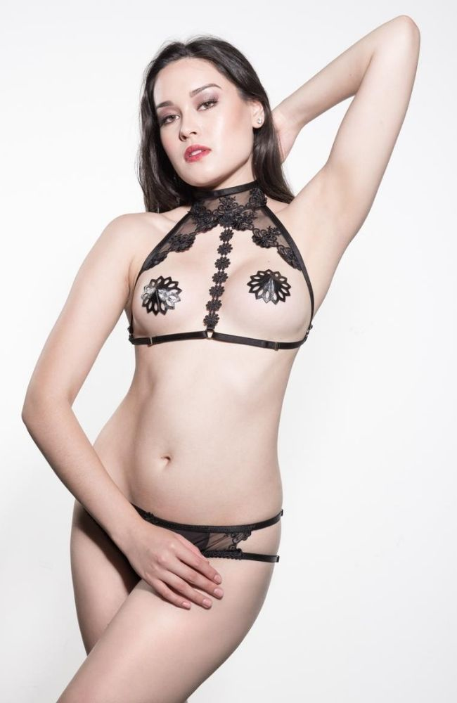 Amber and Indigo Lingerie Virtue Lace Harness is a delicate and striking lace harness that wraps around the neck and under the bust with satin strapping and gold hardware.