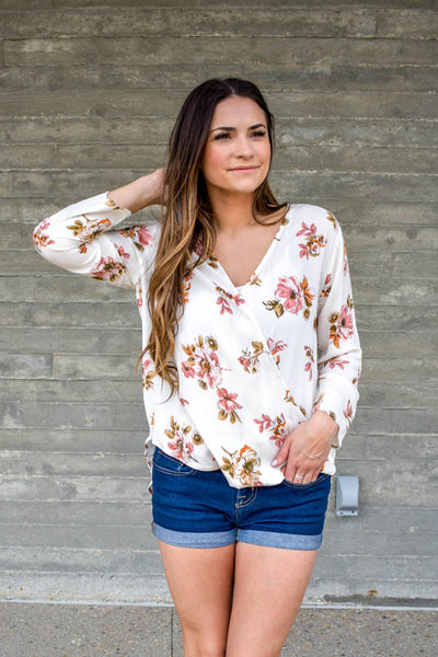 Ivory floral wrap front blouse