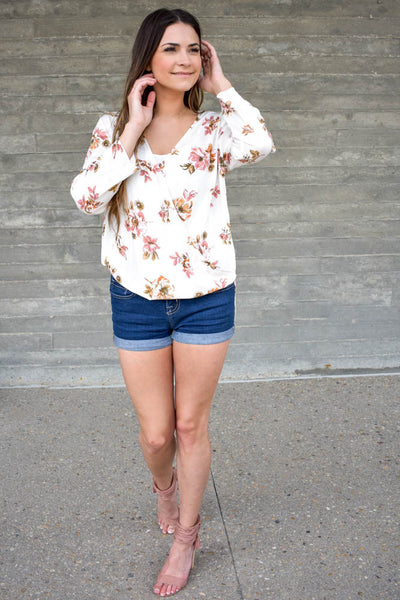 White blouse with floral wrap front