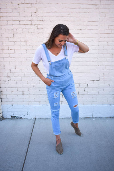 Women's distressed denim overalls