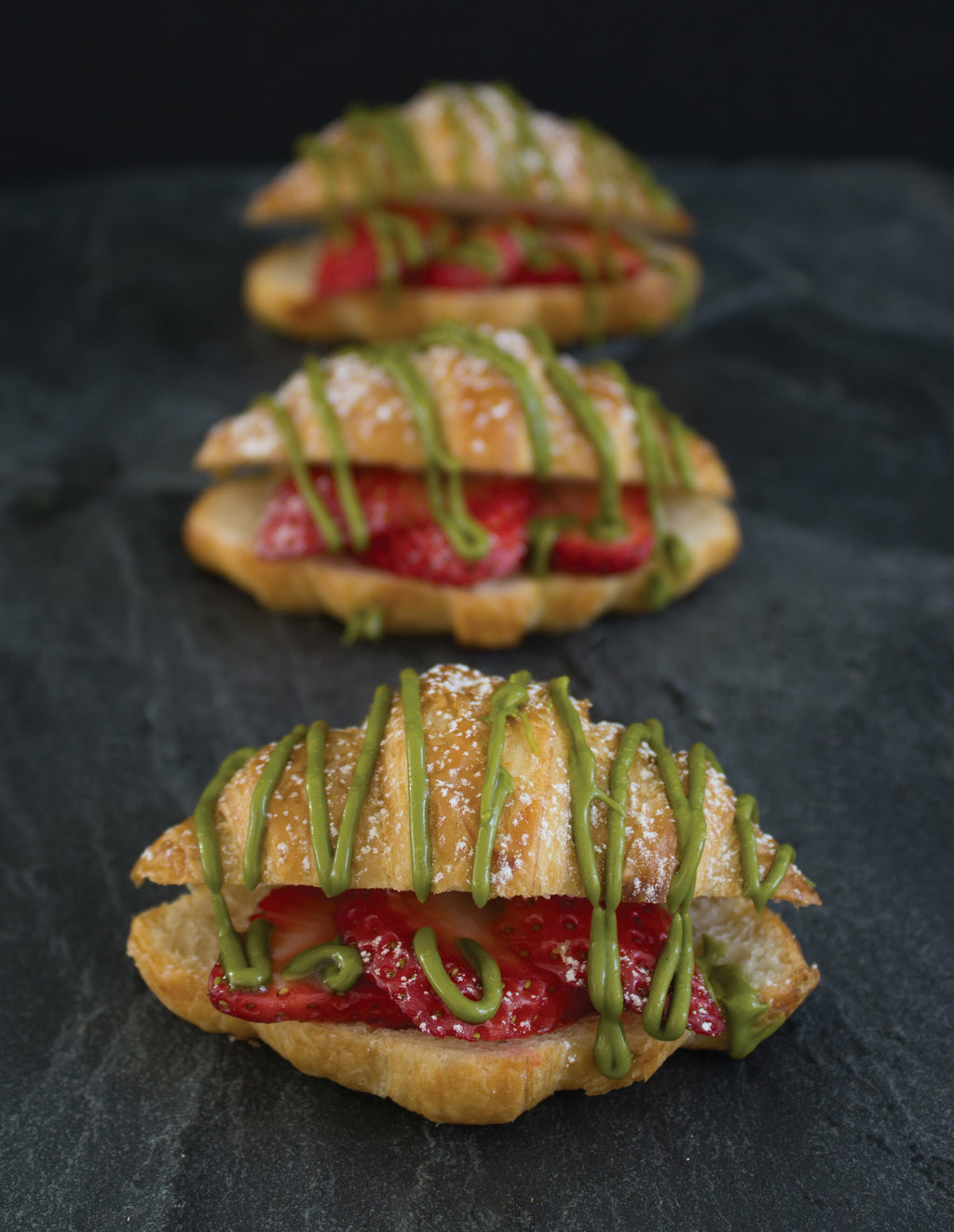 Mini Croissants Stuffed with Strawberries and Decorated with Matcha Pistachio Crème Spread & Powdered Sugar