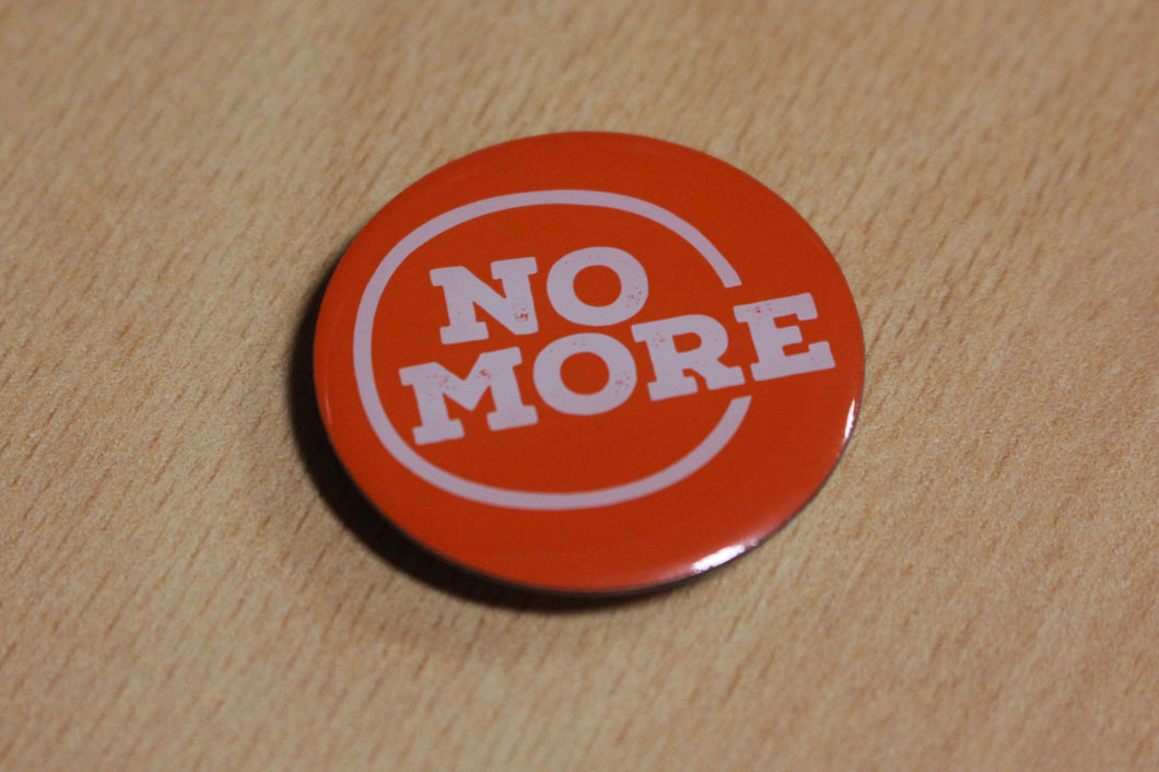 NO MORE badge (magnet backing)