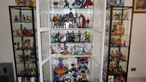 anime figures and collectibles in display case