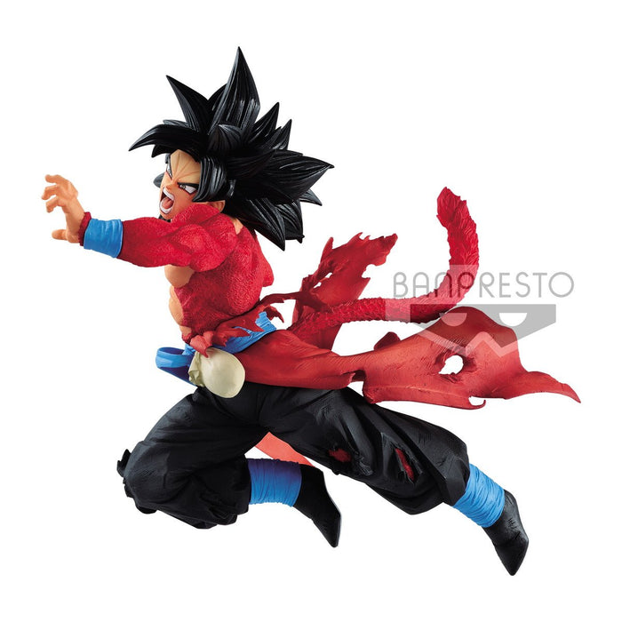 Figure of Son Goku in his Super Saiyan 4 form from Dragon Ball. He is swinging his fist.