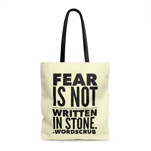 """Fear is not written in stone"" Tote Bag"