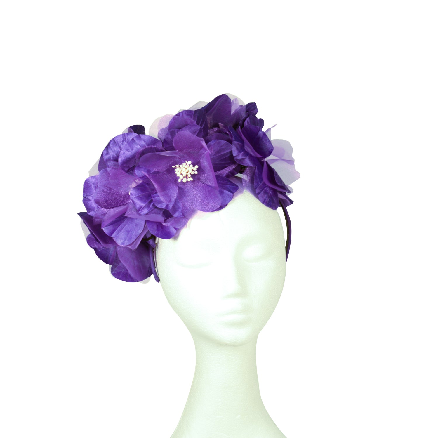 Purple fabric flower with white centre fascinator