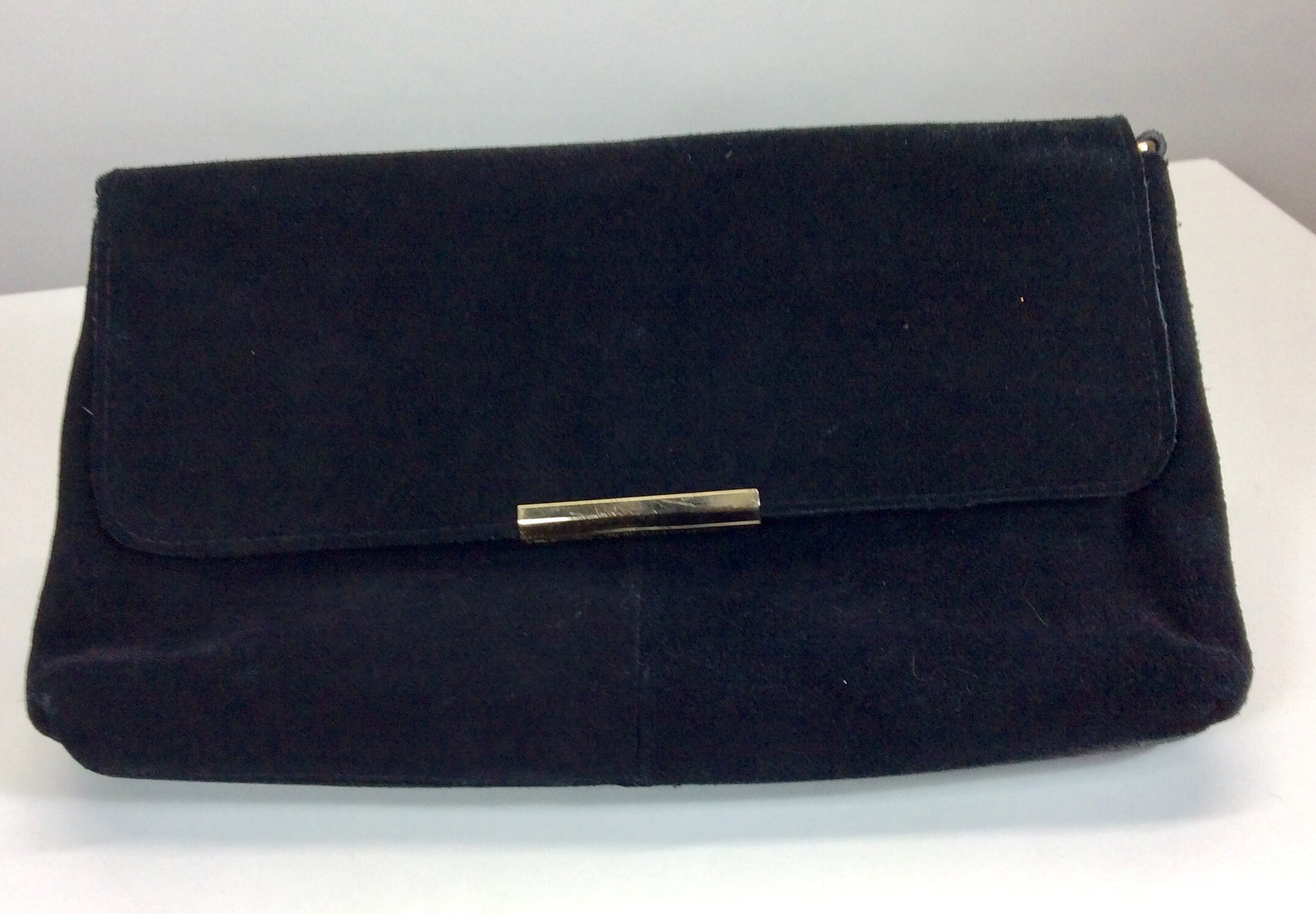 Black suede clutch with gold clasp