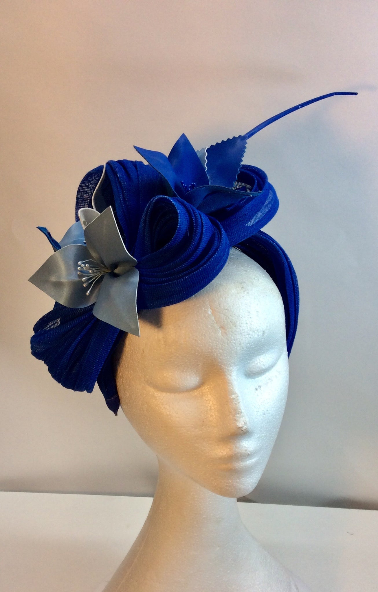 Cobalt blue fascinator with pale blue flowers