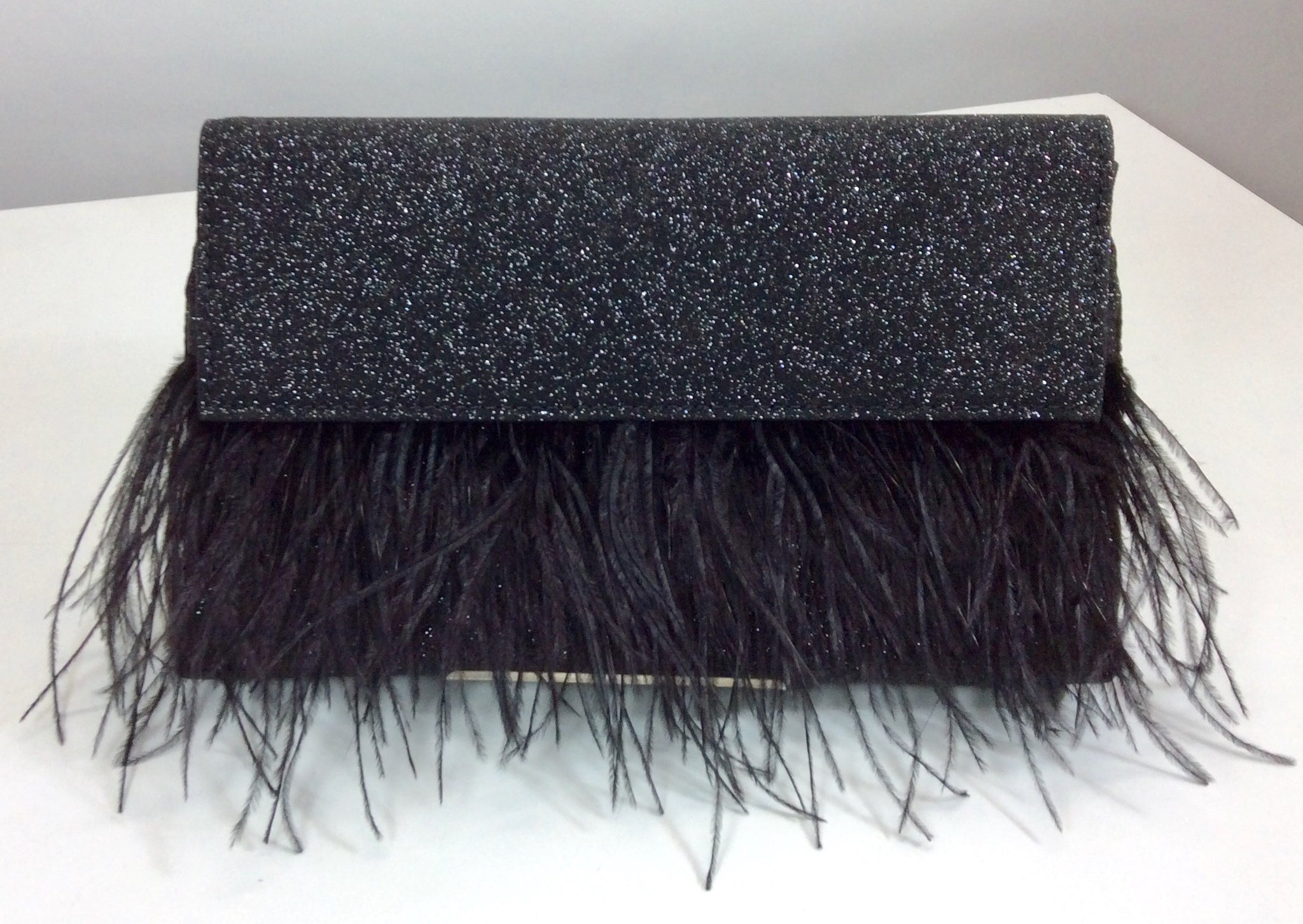 Sparkling black 20S style evening bag featuring feathers