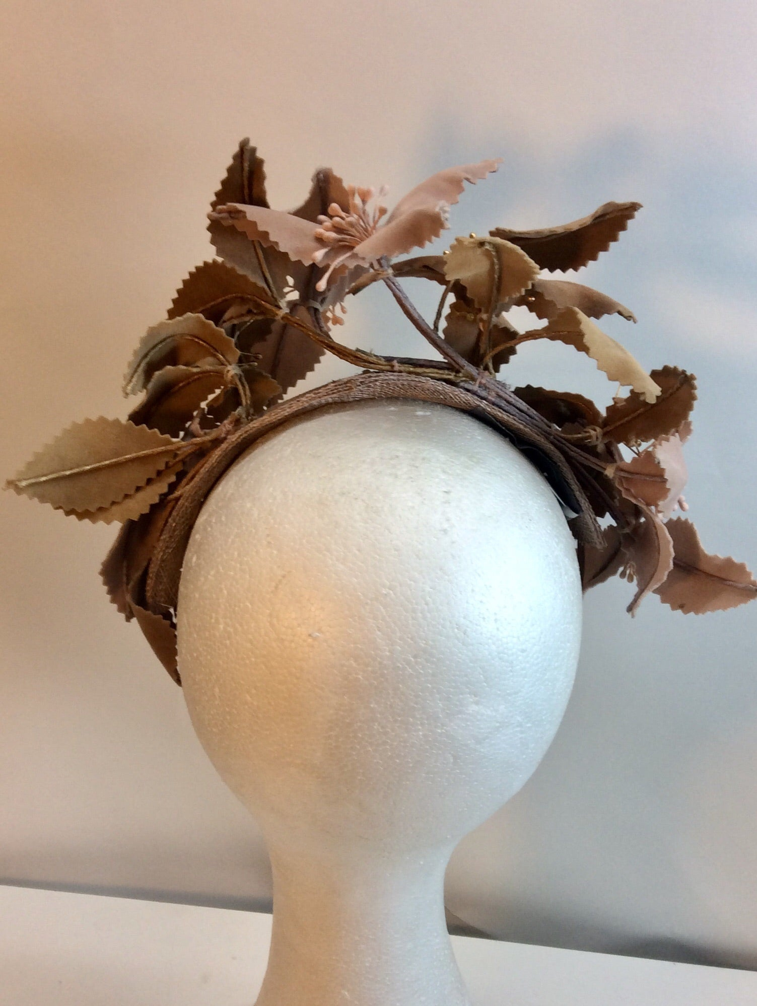 Floral fascinator in shades of caramel and tan