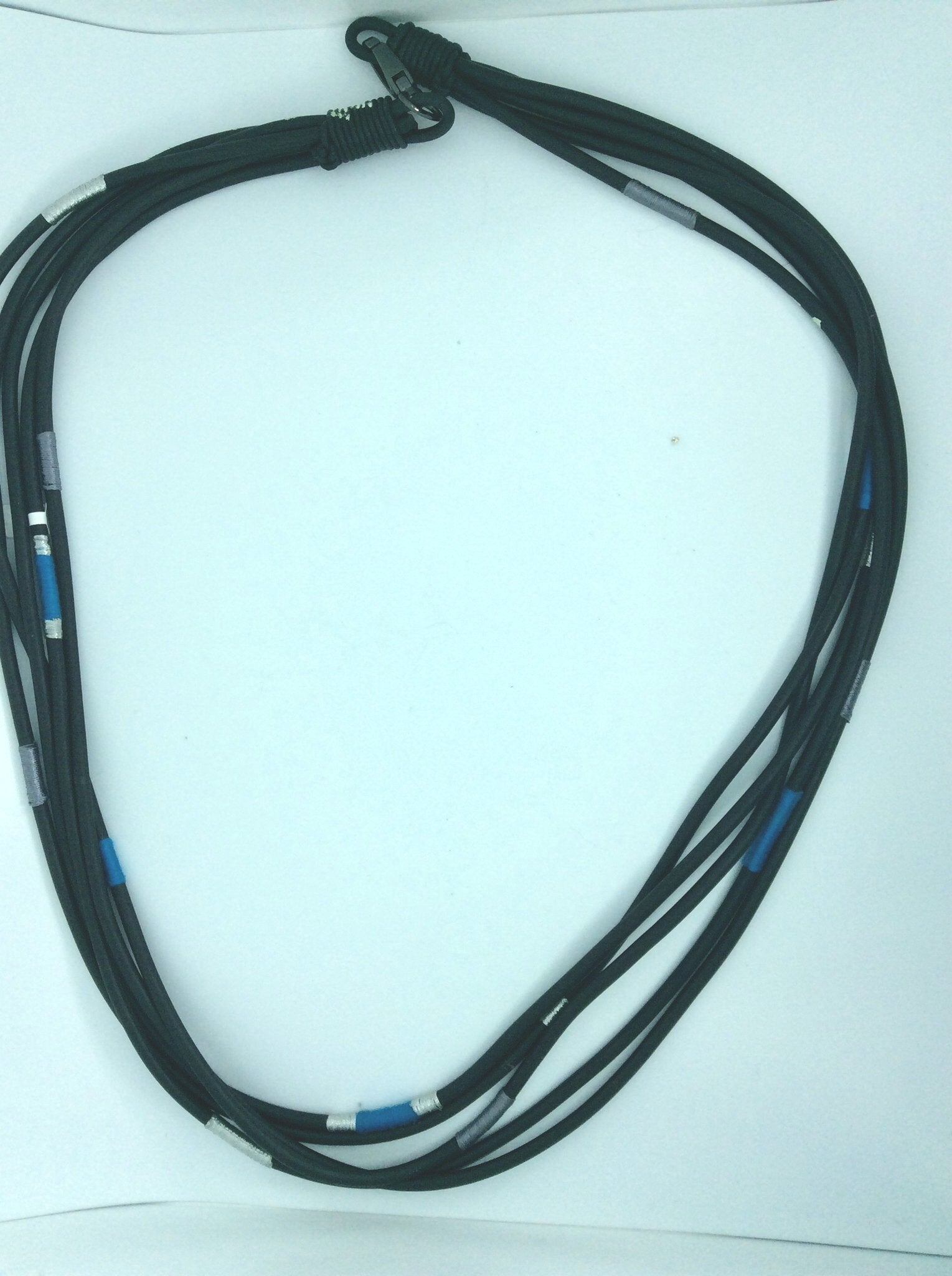 Long sophisticated multi strand rubber necklace