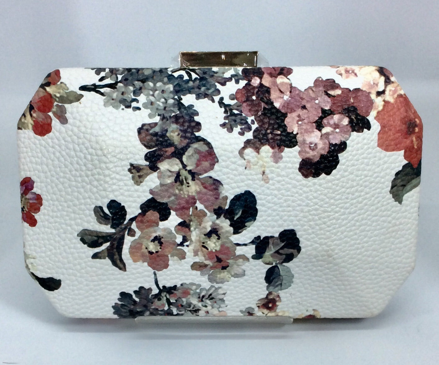 Flower patterned cream and pink clutch
