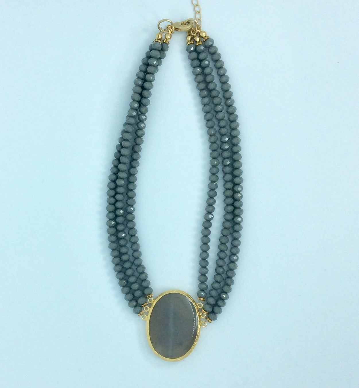 Elegant grey stone and crystal necklace set in gold plate