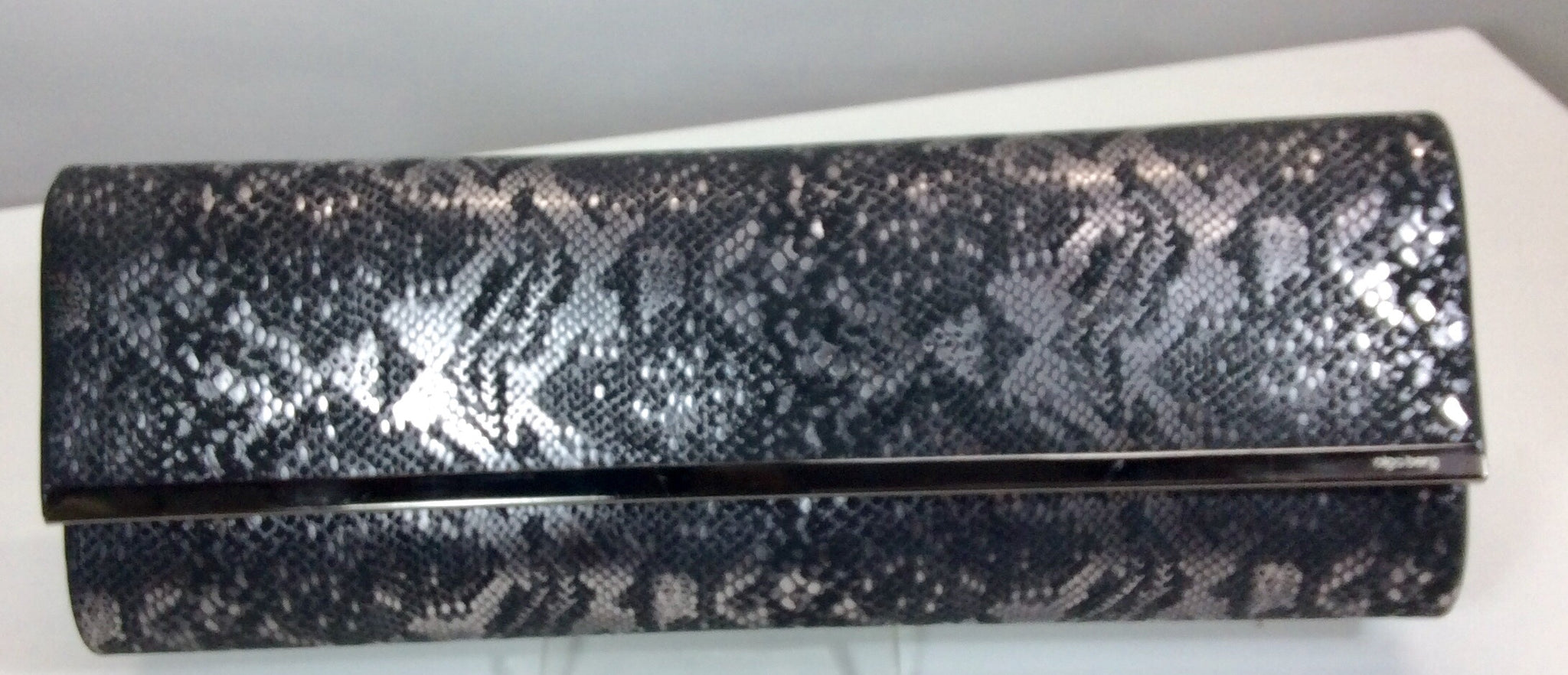 Elongated silver and black snakeskin evening bag