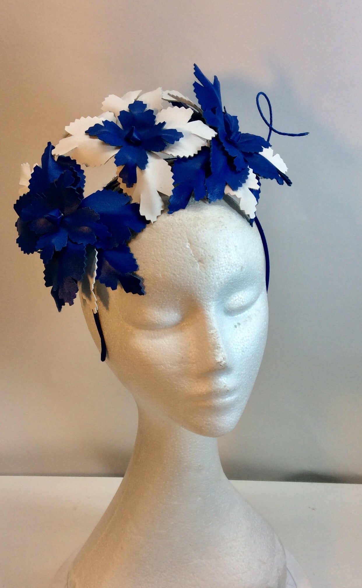 Cobalt blue and white leatherette floral fascinator