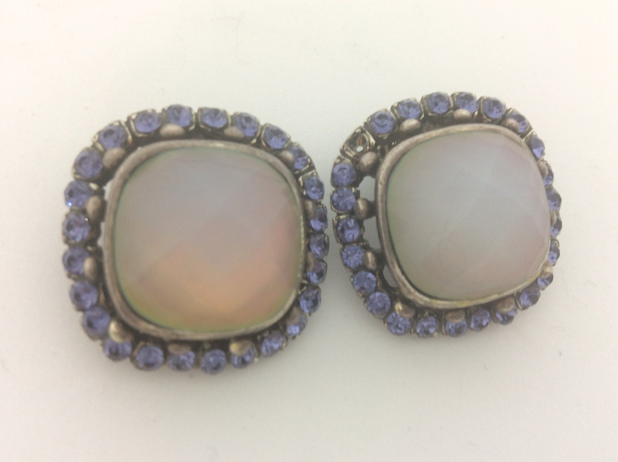 French gold clip on earring with large white opal crystal surrounded by provence lavender crystals