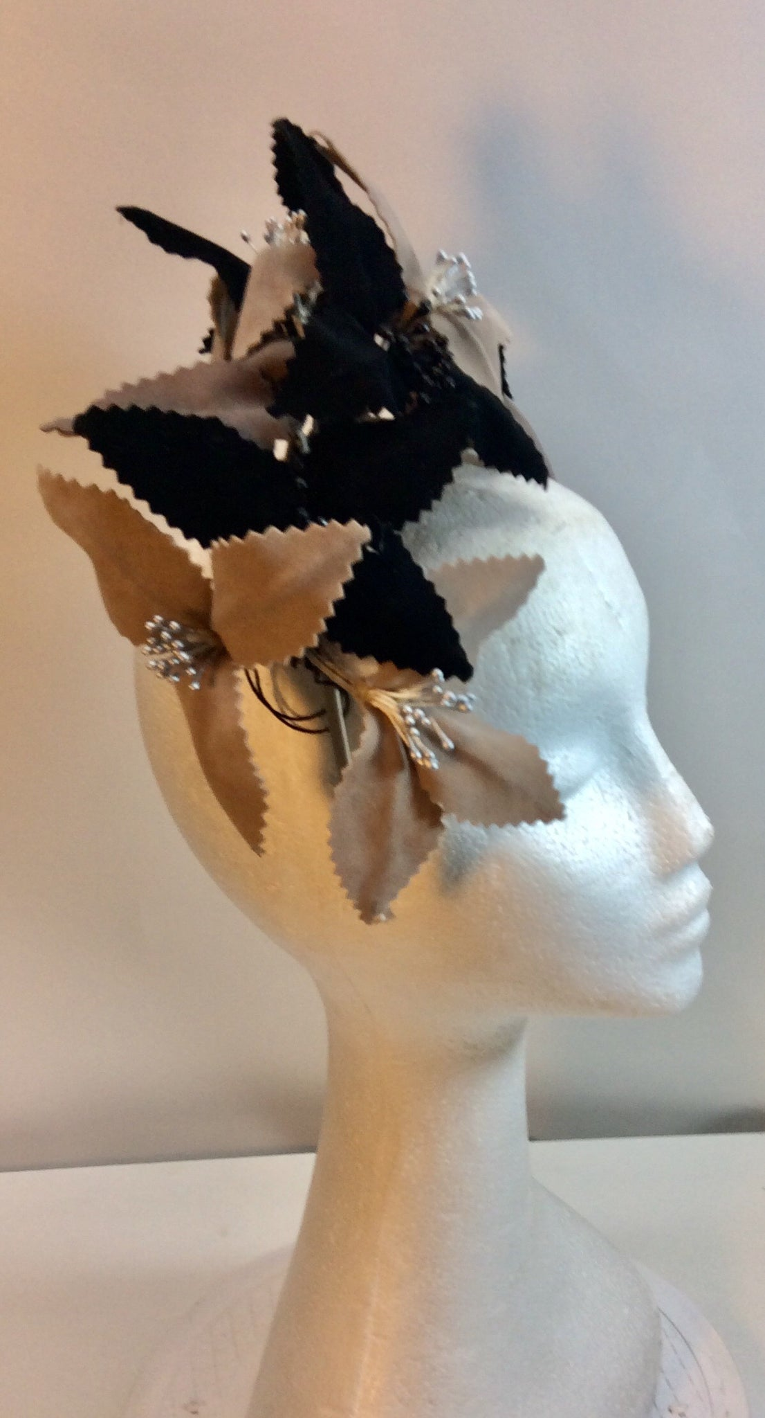 Black beige and taupe floral fascinator on straw coloured band