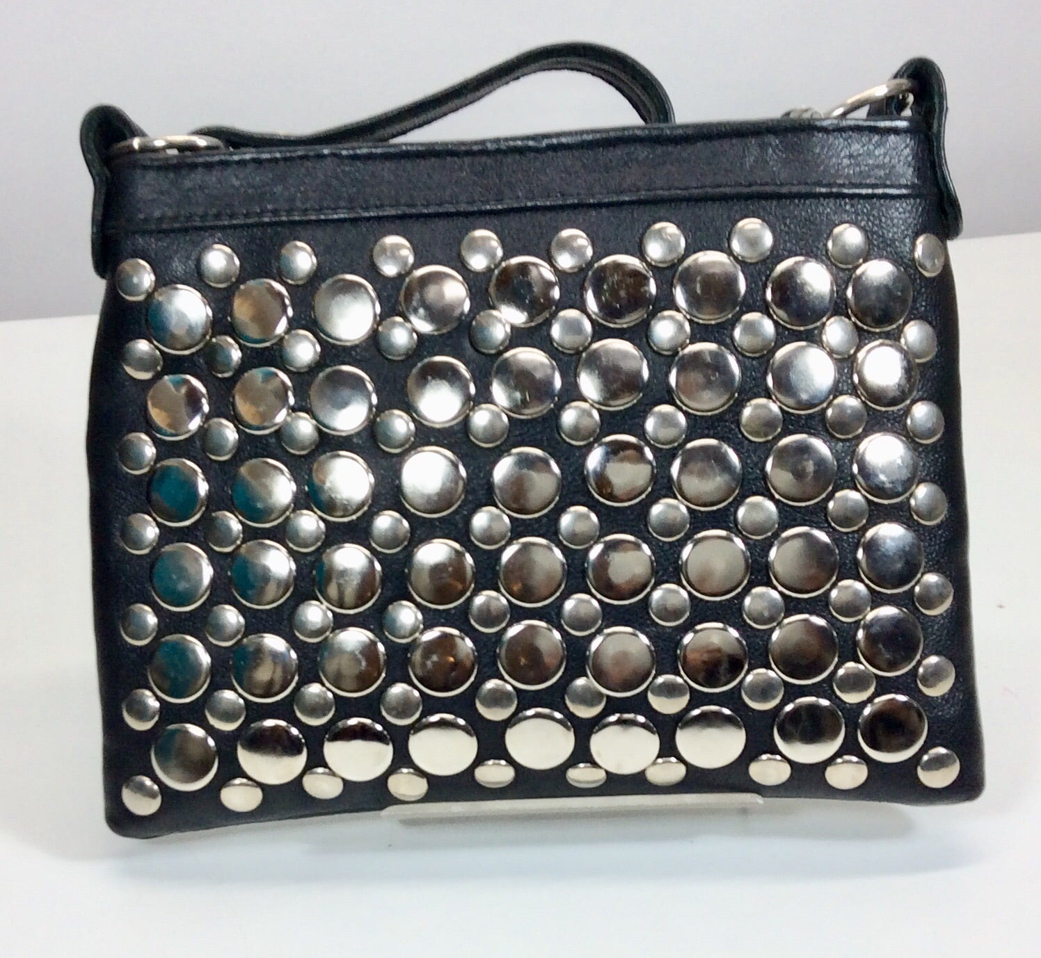 Silver studded small pouch black leather bag
