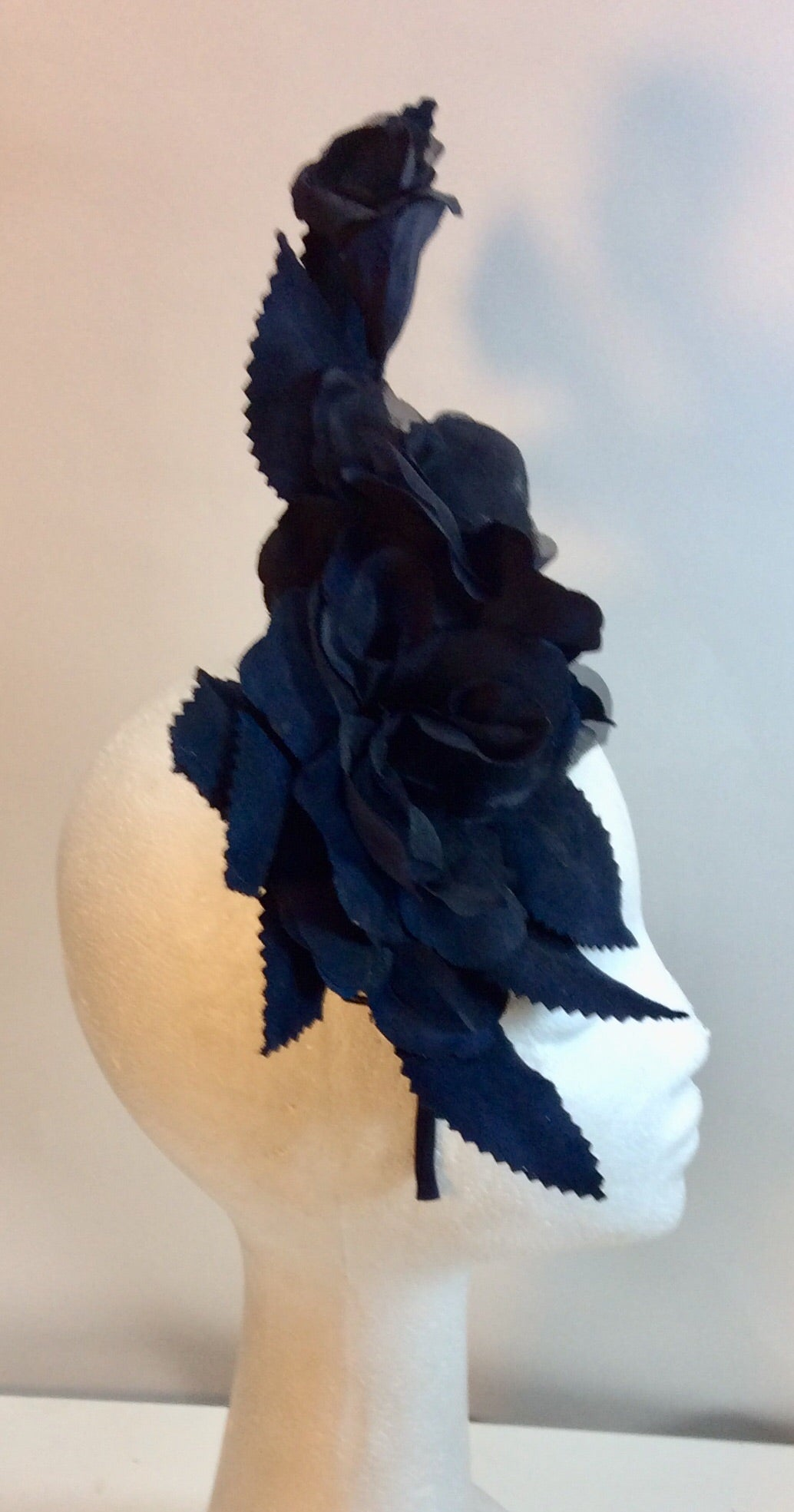 Navy blue floral and leaf fascinator