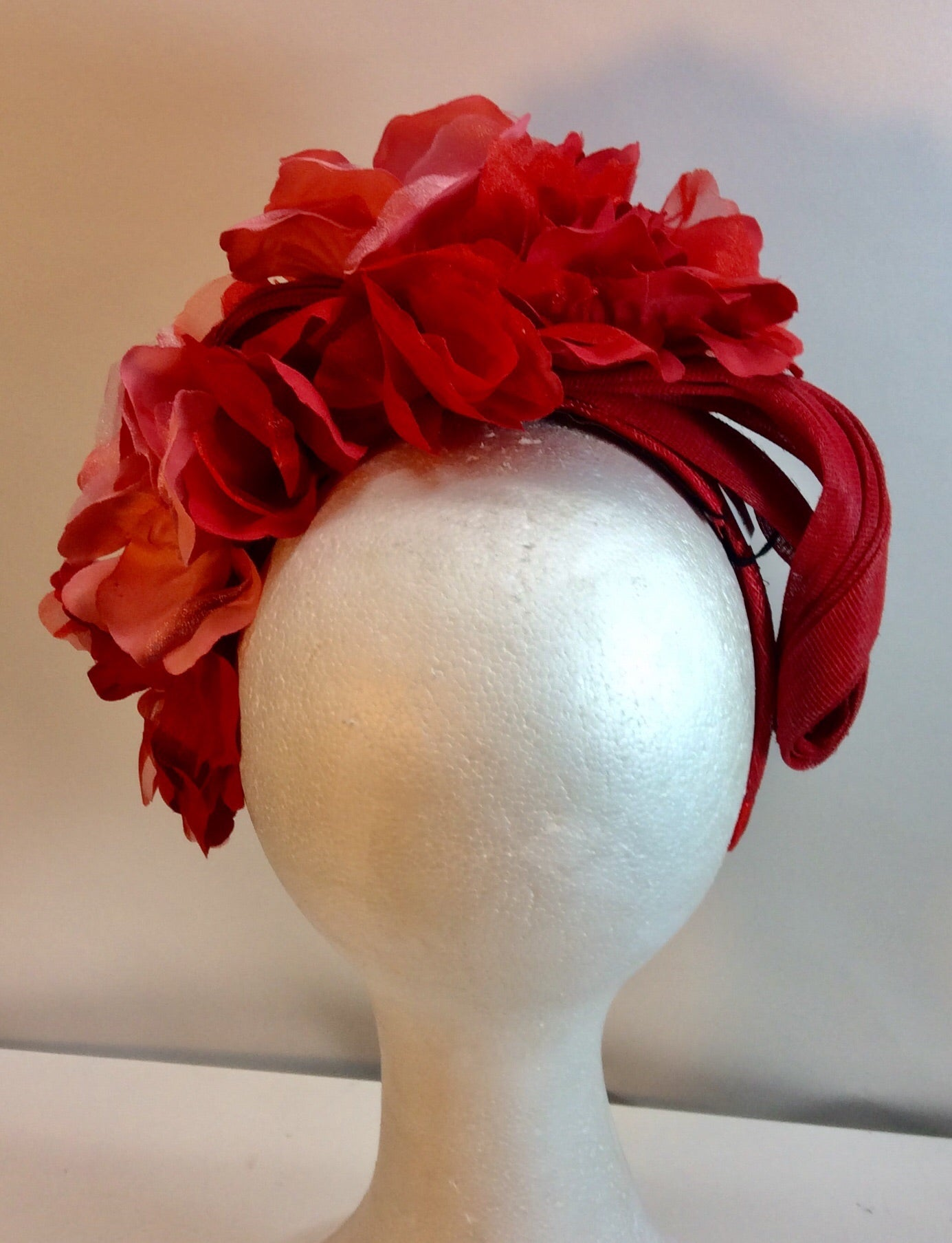 Shaded red and coral floral fascinator