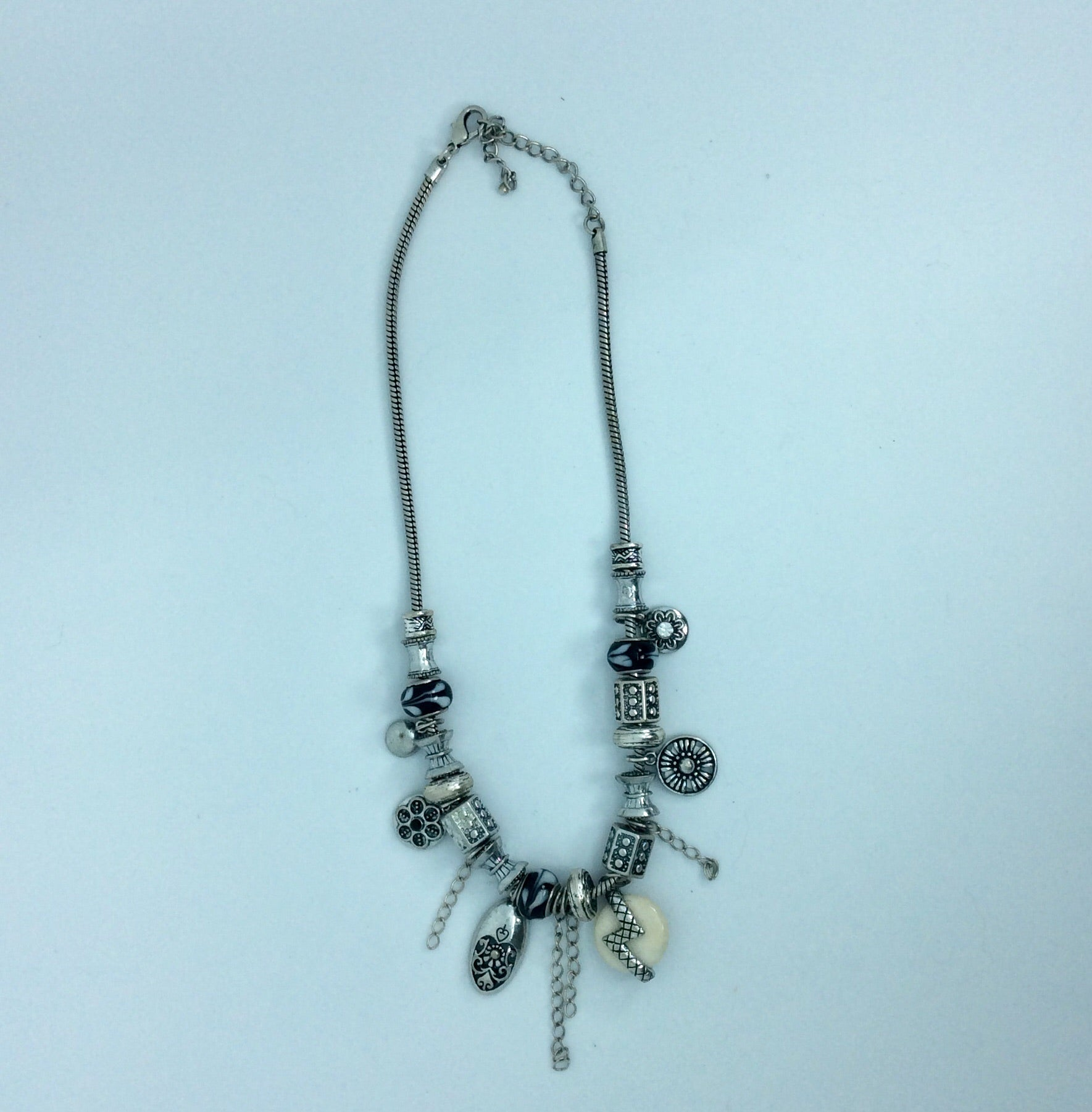 Silver ethnic charm necklace with black and white beads