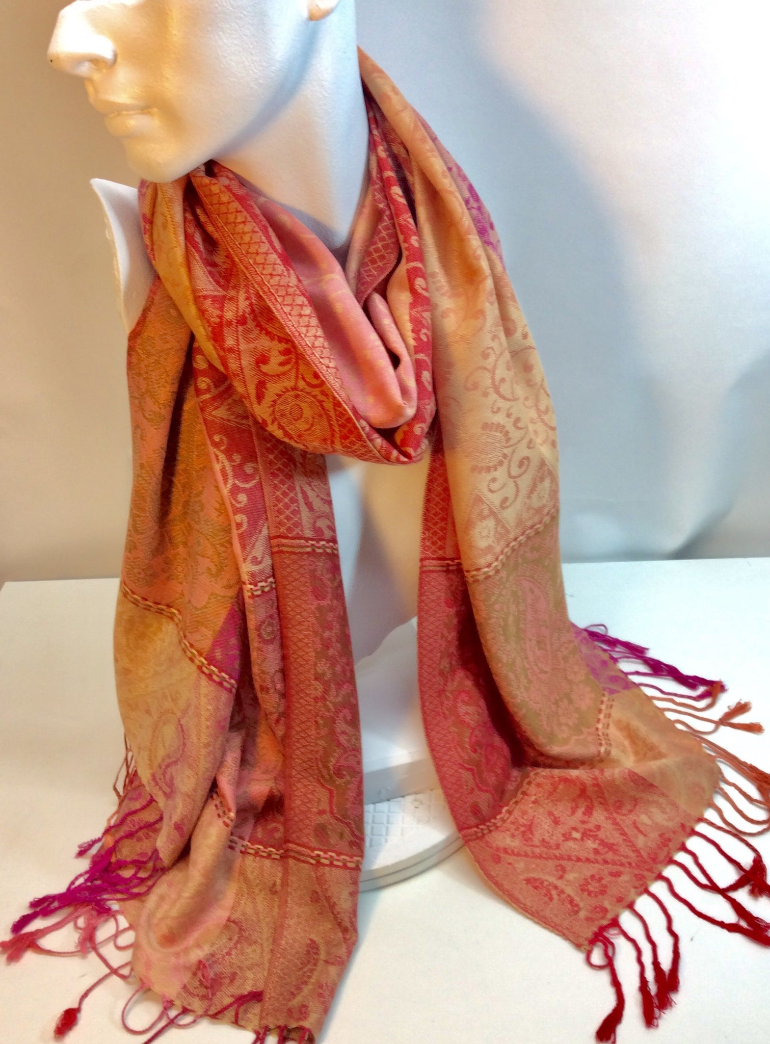 Orange pink and red paisley patterned scarf