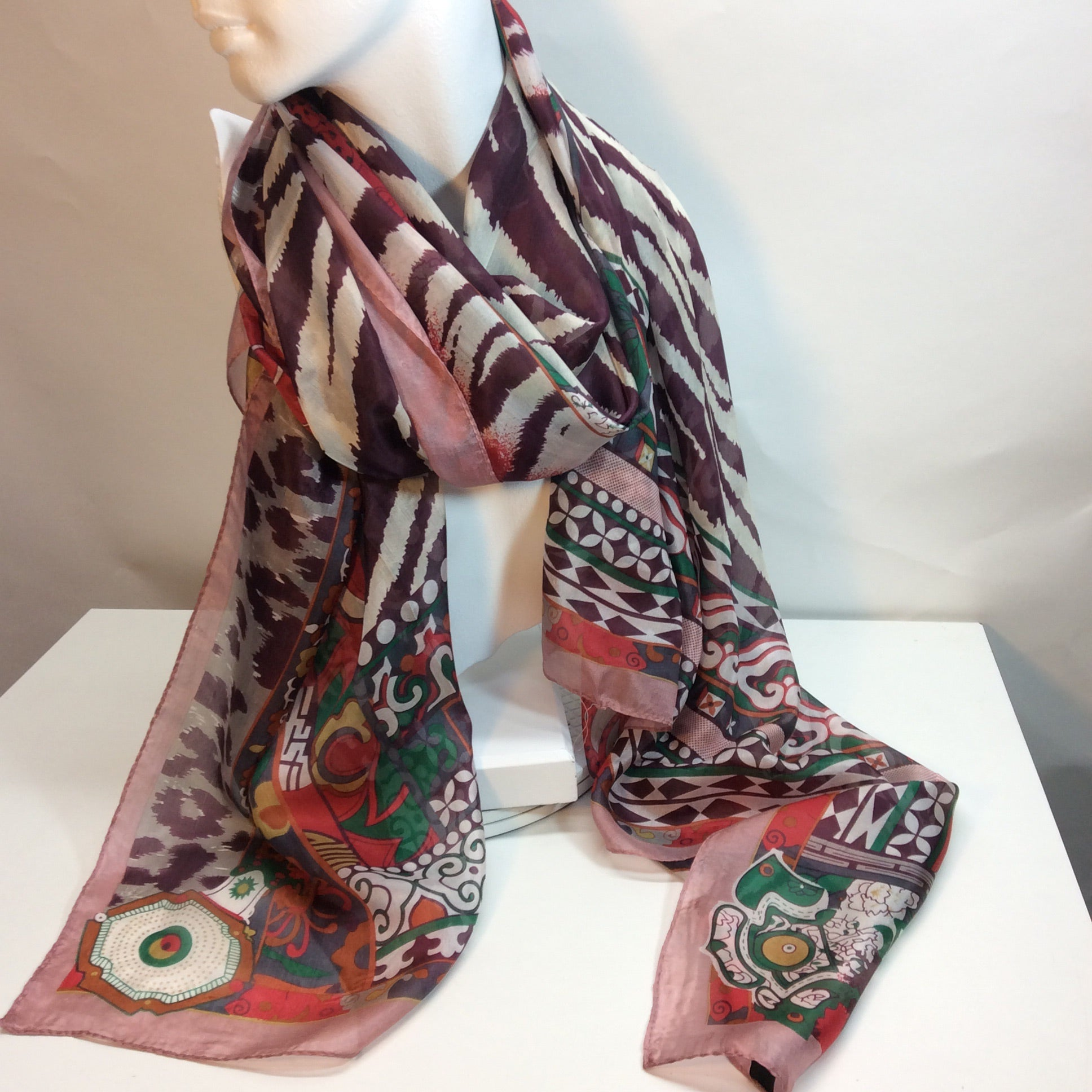 Symmetrical border with animal print centre on this beautiful silk scarf