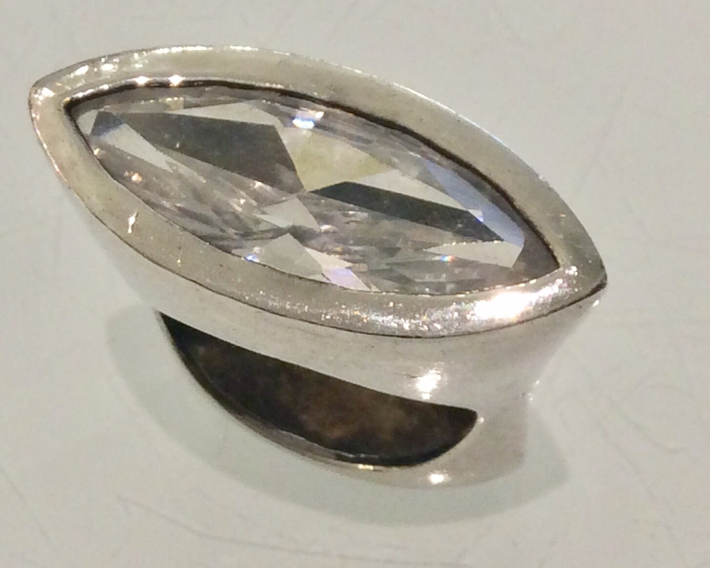 Raised silver ring with crystal inset