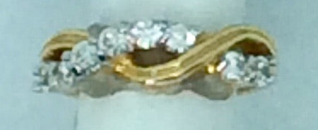 Gold twisted ring with diamanté's