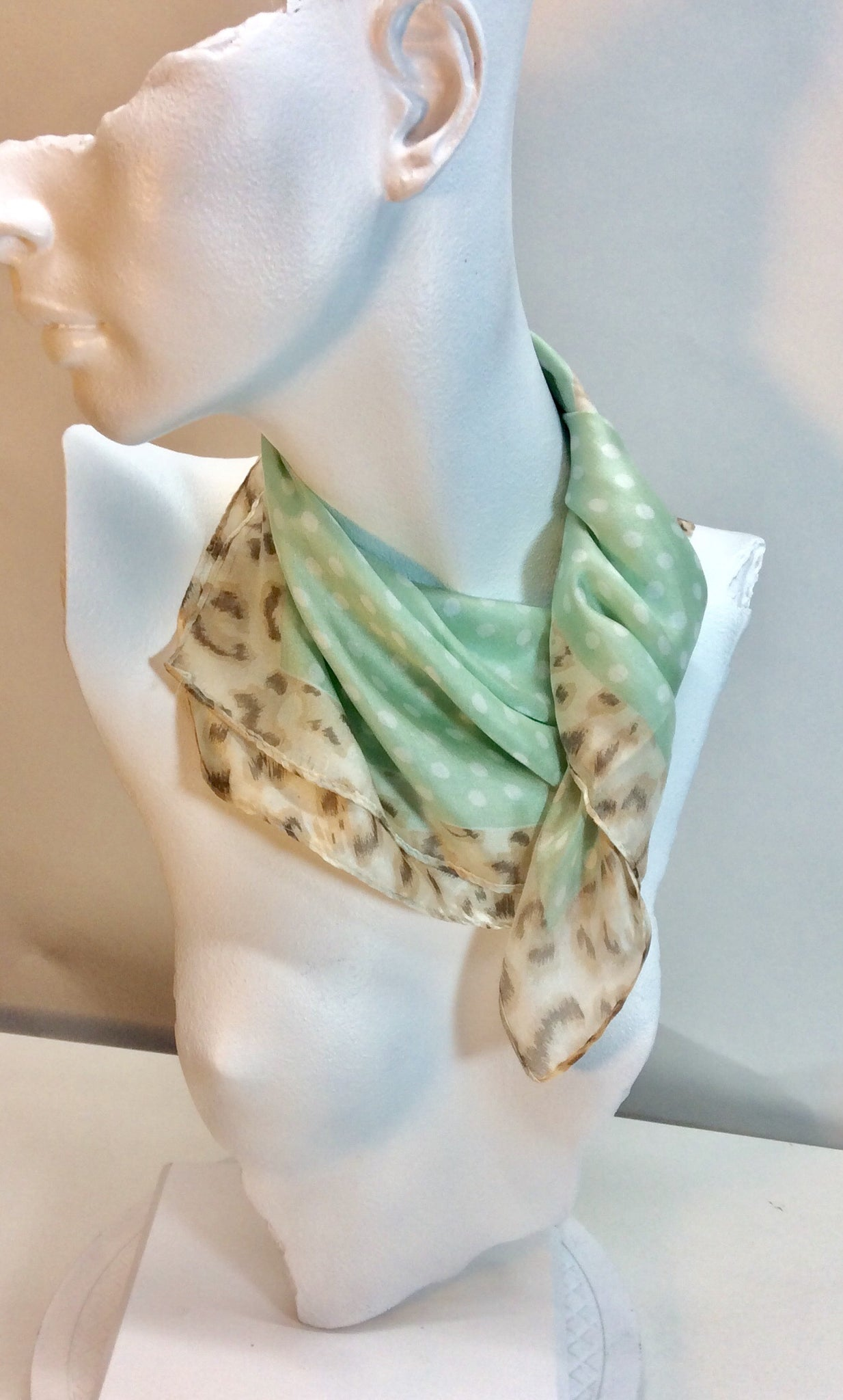 Square silk scarf in pale green with animal print border