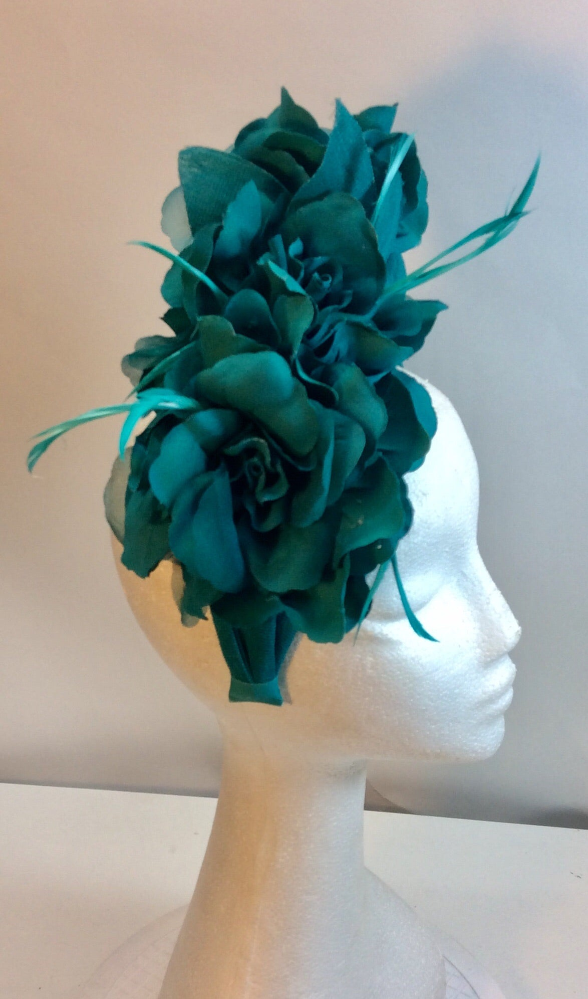 Aqua green floral and feather fascinator