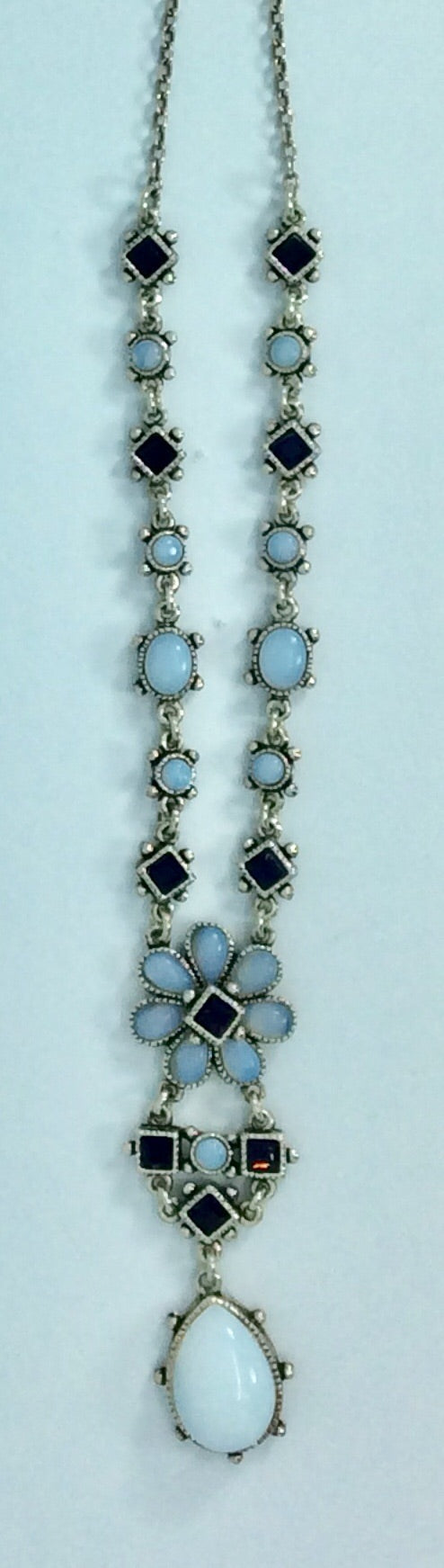 Feminine design with pale blue and amber stones made in France