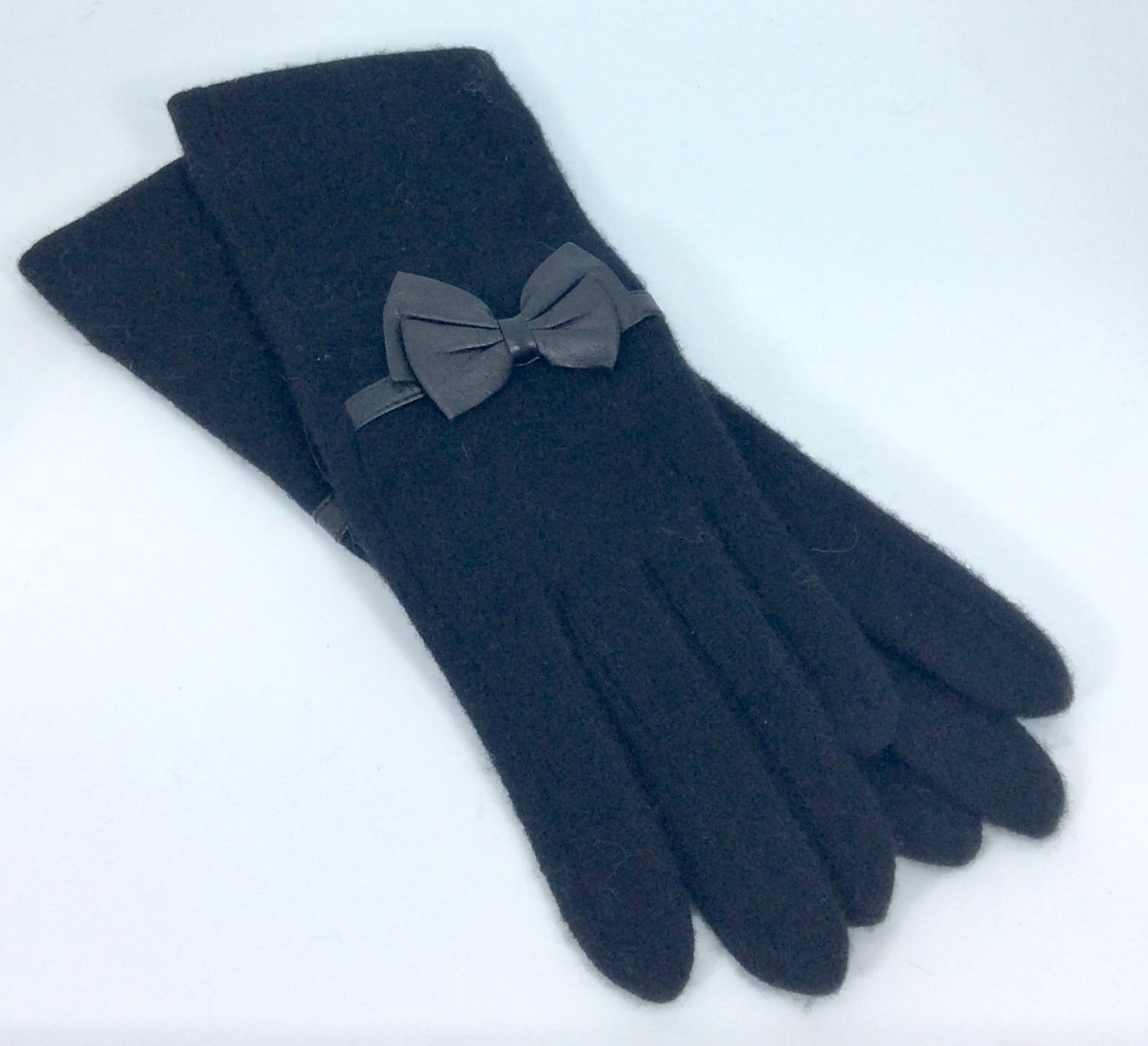 Longer length black woollen gloves with bow detail