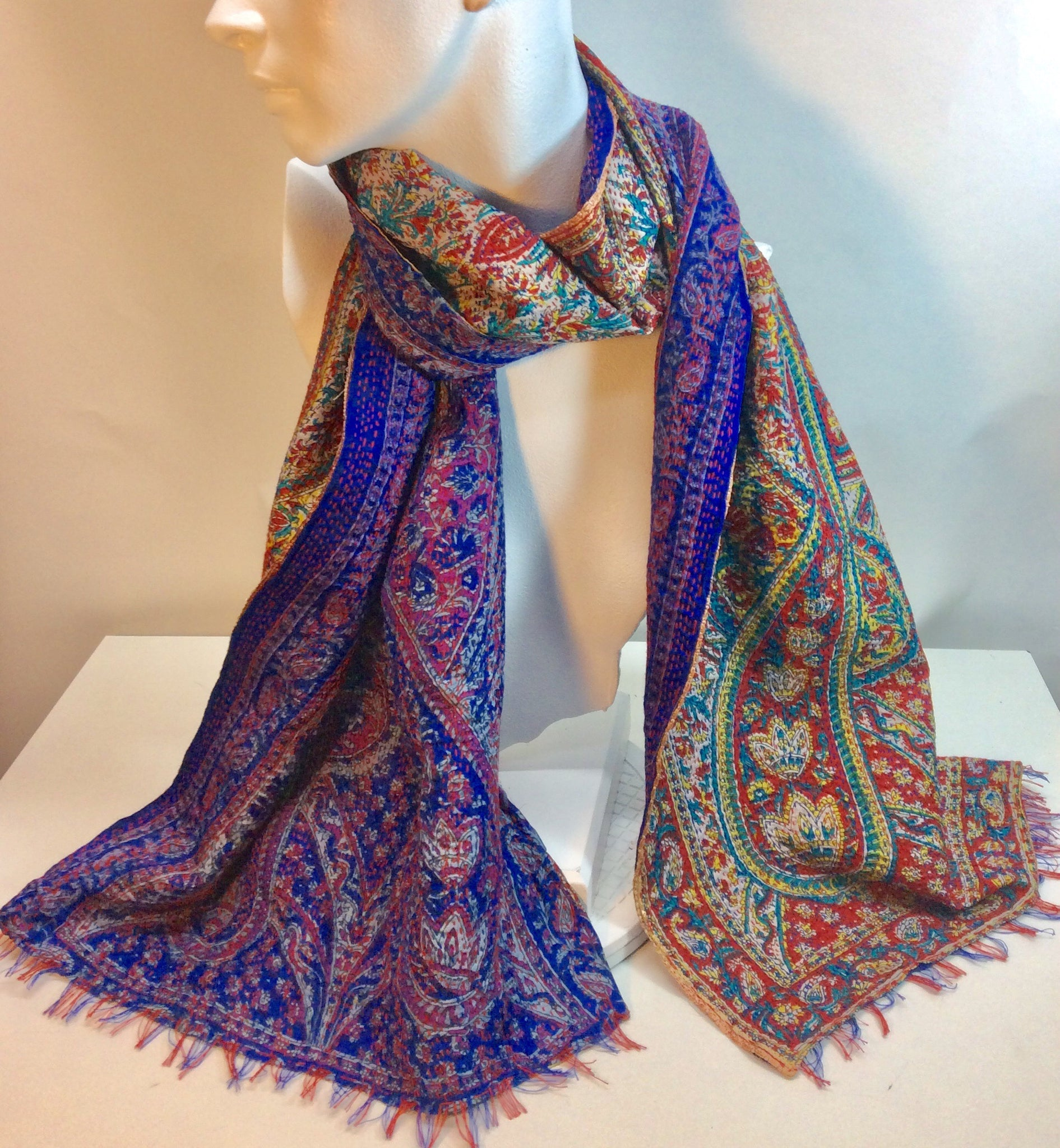 Royal blues and reds feature on this double sided silk scarf