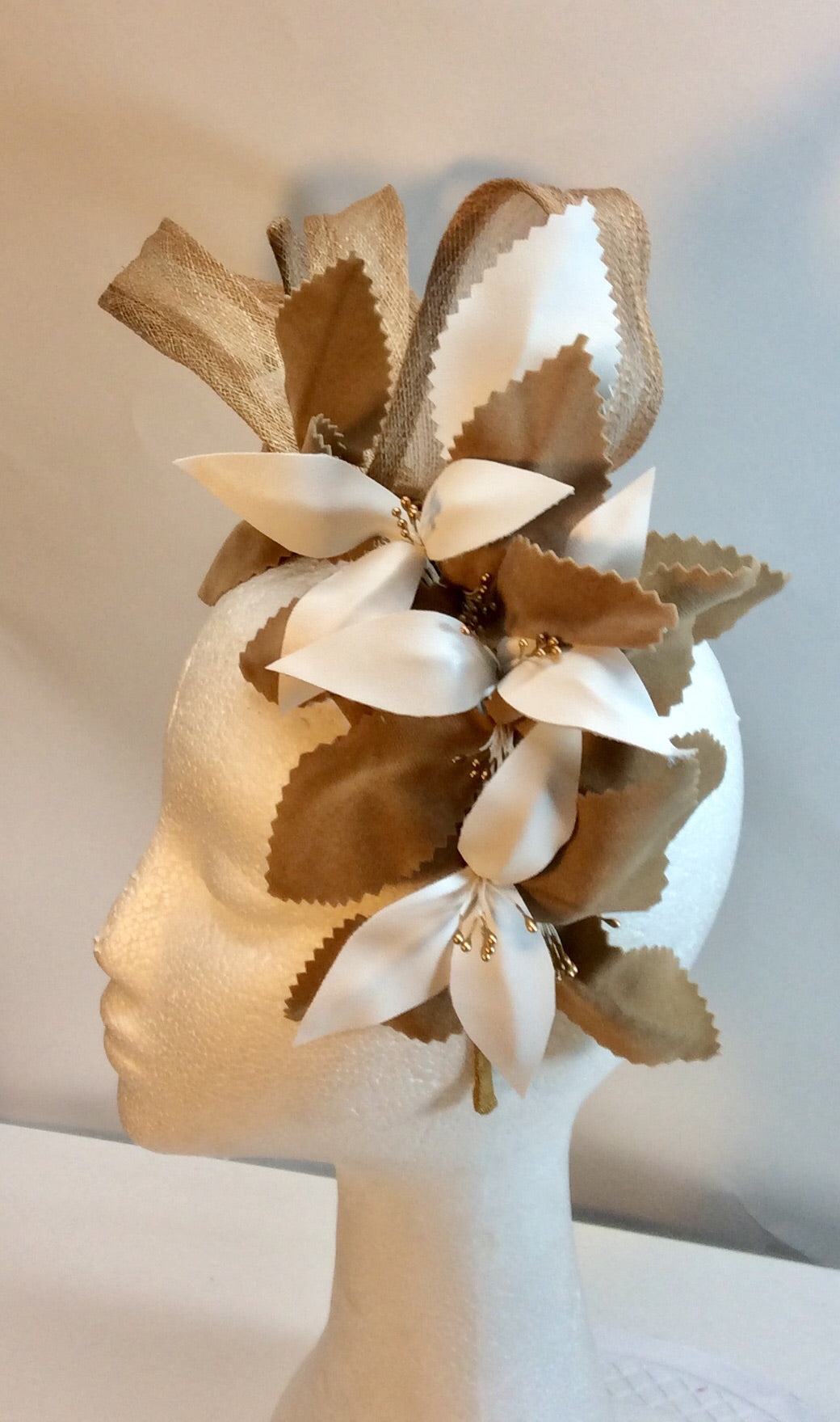 Taupe and white floral fascinator with straw coloured band
