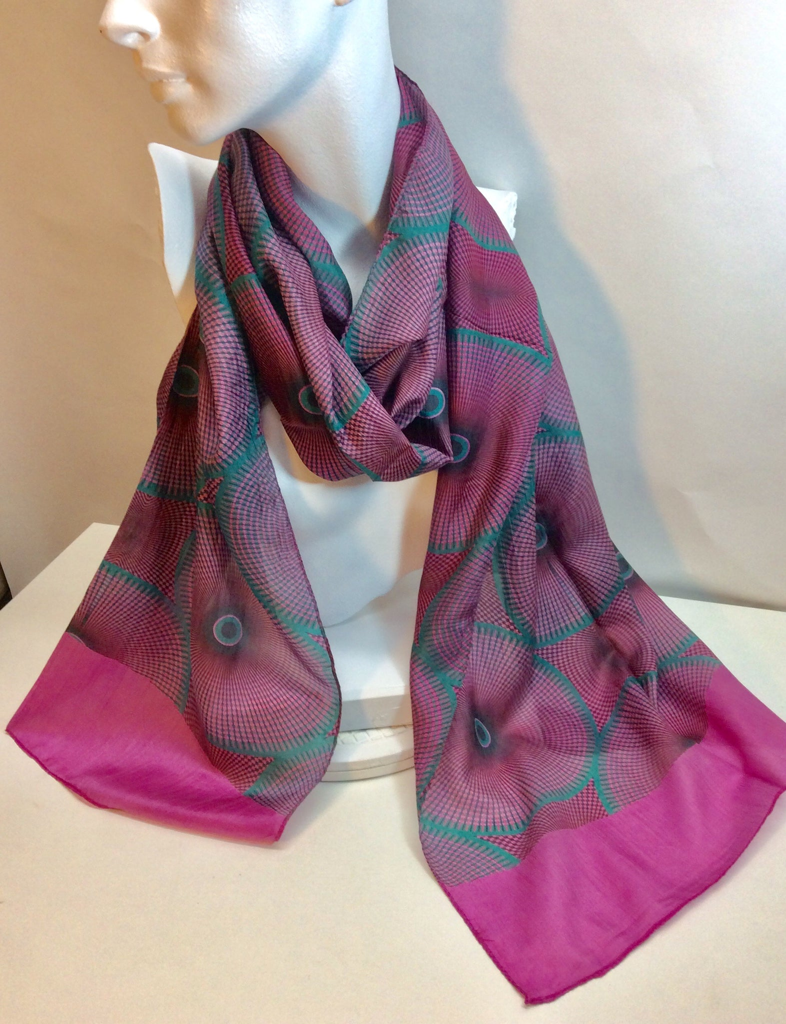 Pink circular design on this silk scarf