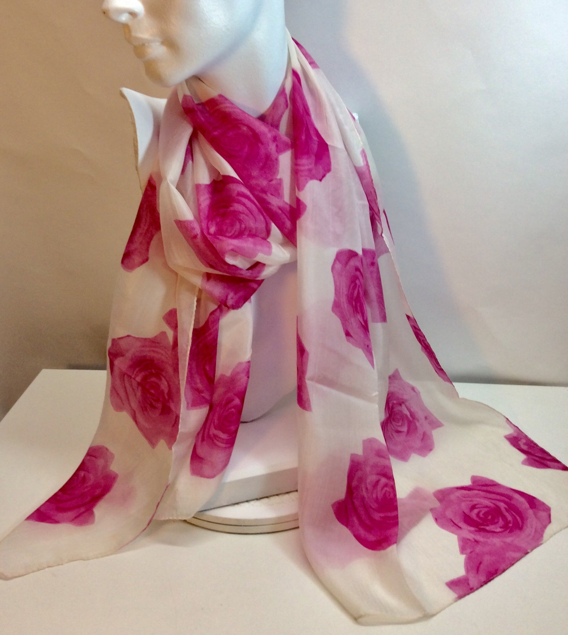Summery pink roses feature on this silk scarf