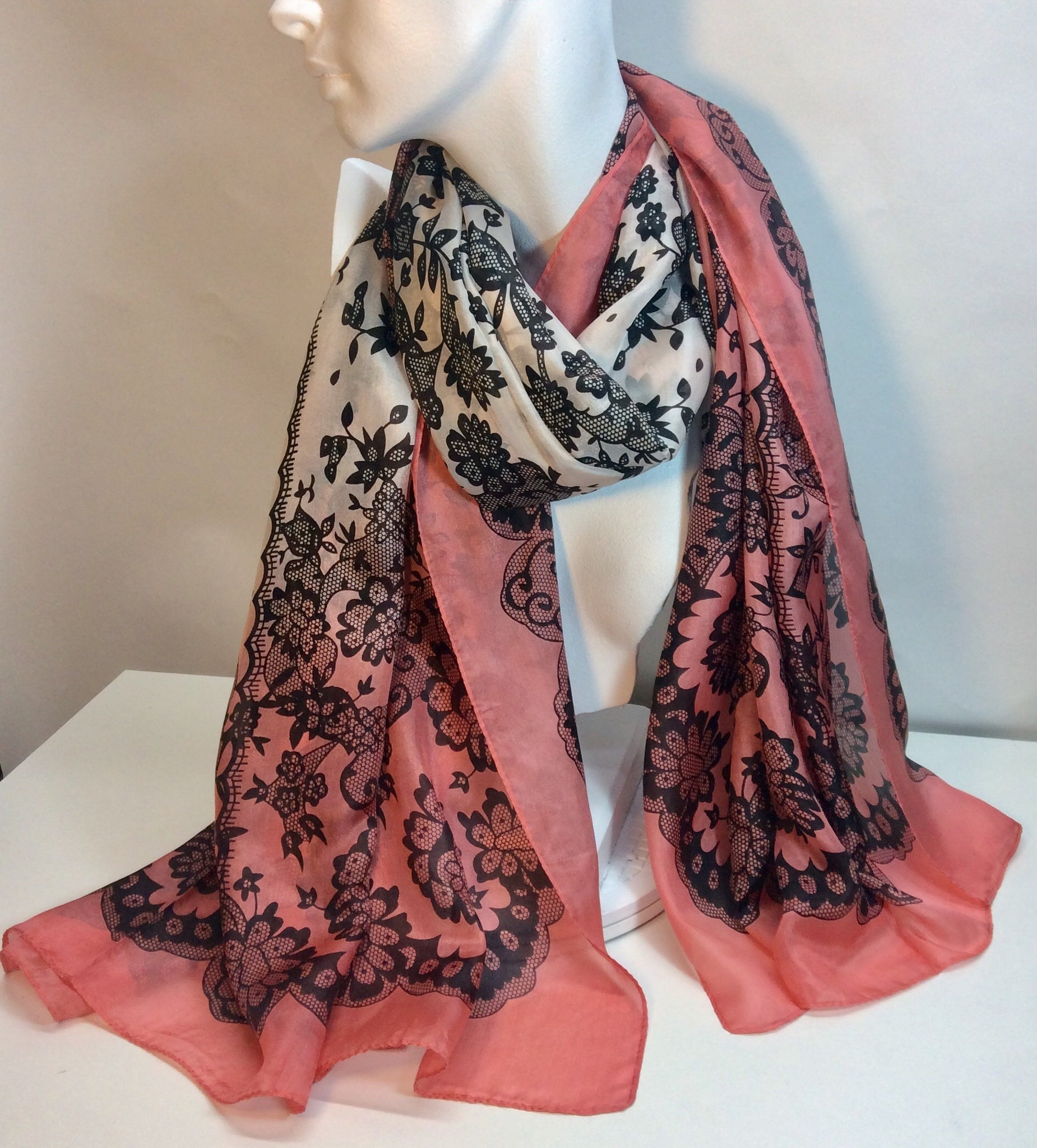 Dramatic black print on this stunning silk scarf