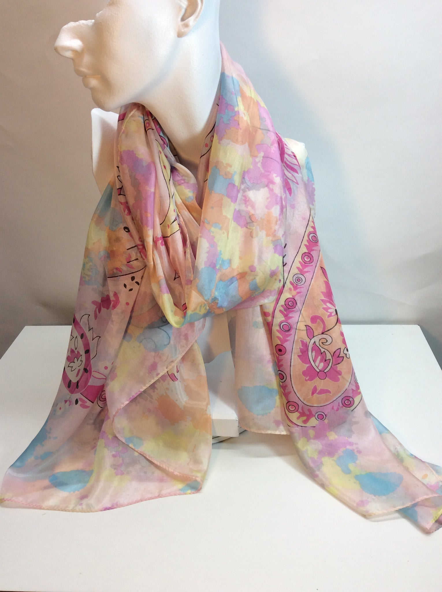 Pastel spring pinks and blue feature in this stunning silk scarf